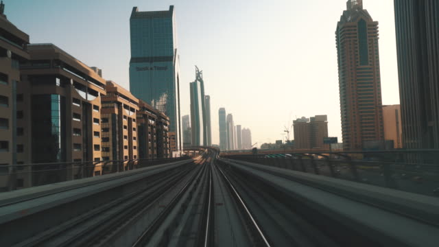 Dubai Metro transportation drive with skyscrapers
