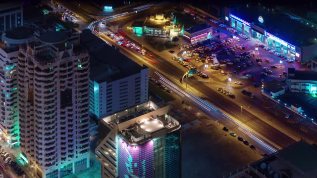 dubai night illumination parking traffic street roof top view 4k time lapse united arab emirates video