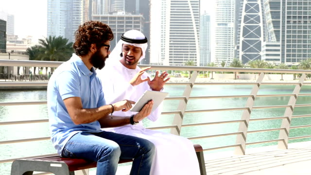 Dubai - Young people using digital tablet in the city - Stock video video