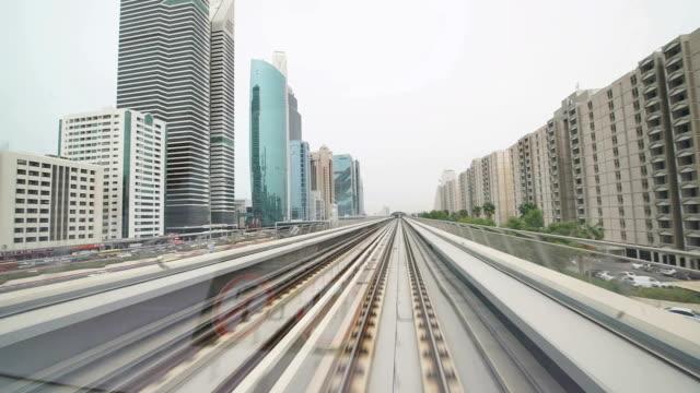 POV Dubai's metro runs along skyscrapers