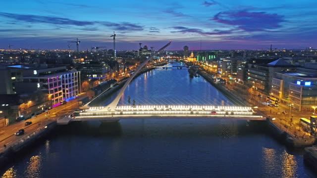Dublin by night flying backwards over Liffey video