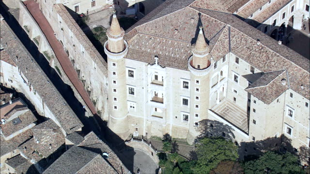 Ducal Palace, Urbino  - Aerial View - The Marches, Pesaro and Urbino, Urbino, Italy Over fatade of Ducale Palace in Urbino lombardy stock videos & royalty-free footage