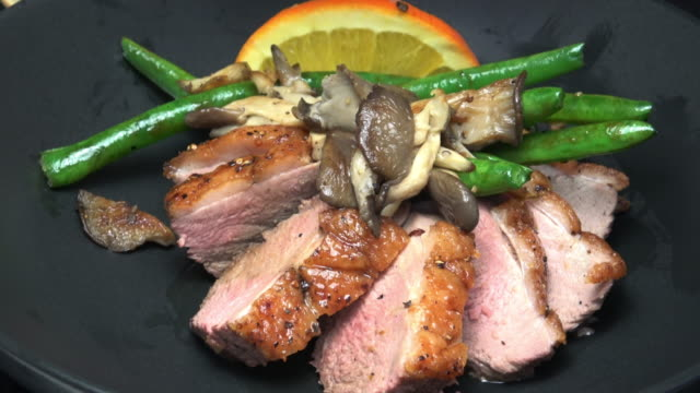 Duck Breast L'Orange Sliced Duck Breast with Wild Mushrooms and Green Beans seared stock videos & royalty-free footage