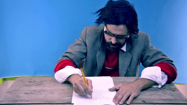 dumb writing a letter - peruk stok videoları ve detay görüntü çekimi