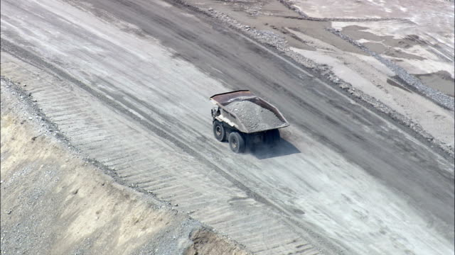Dumper Trucks Working In Copper Mine  - Aerial View - Montana,  Silver Bow County,  helicopter filming,  aerial video,  cineflex,  establishing shot,  United States video