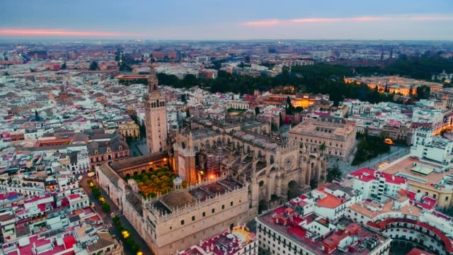 dusk aerial view of seville cathedral - cathedrals stock videos & royalty-free footage