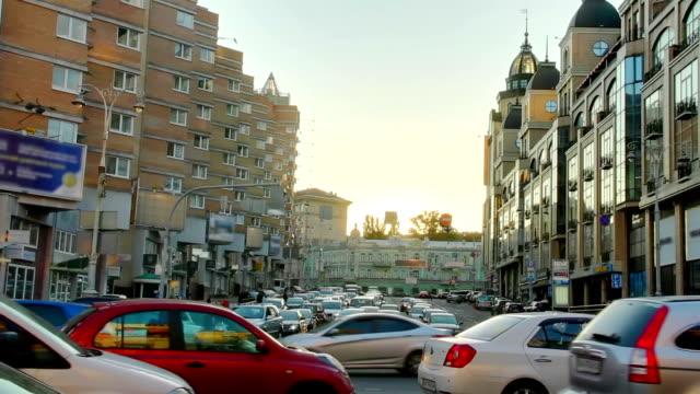 Dusk city traffic jam, street vehicles cars stuck time lapse video