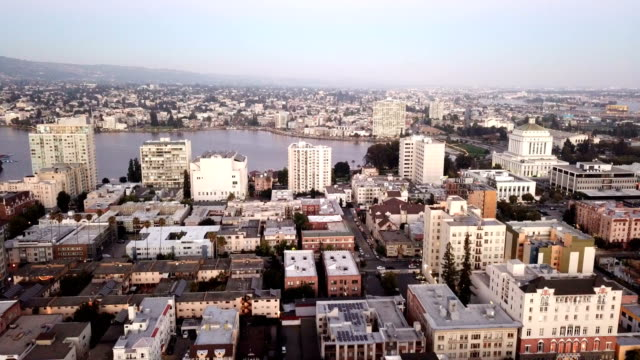 Dusk Falls on The Buildings and Skyline of Oakland, CA and Lake Merritt A tidal lagoon called Lake Merritt is surrounded by the parkland and neighborhoods of Oakland California oakland stock videos & royalty-free footage