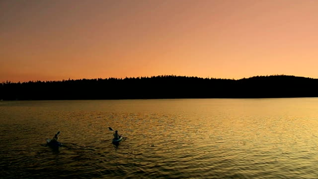 Dusk Kayakers at Sunset Smooth Moving Shot, San Juan Islands video