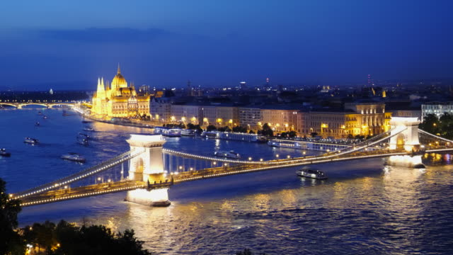 dusk shot of chain bridge and city of budapest dusk shot of chain bridge, danube river and the city of budapest, hungary hungary stock videos & royalty-free footage