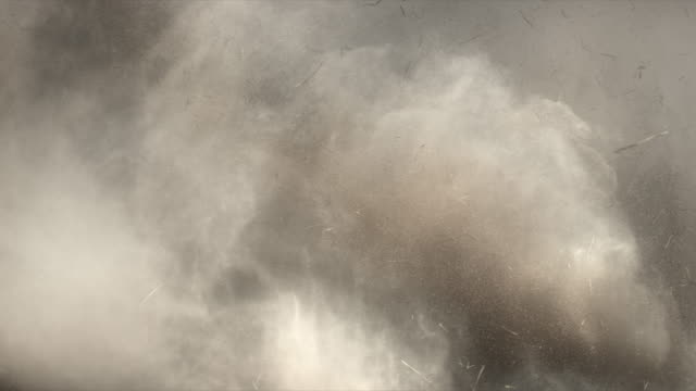 4K Dust and hay explosion cloud descedning in slow-motion