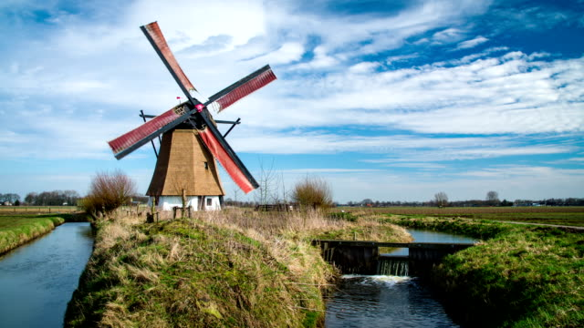 dutch landscape with turning windmill - dutch architecture stock videos & royalty-free footage