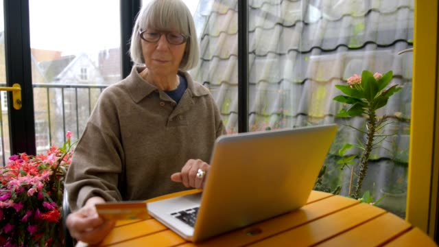 Dutch senior woman using technology video