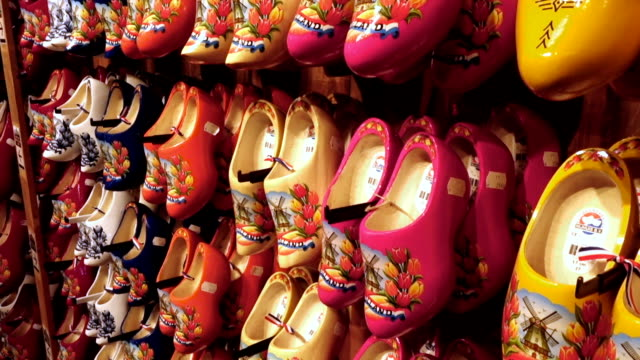 dutch traditional wooden shoes, clogs - amsterdam video stock e b–roll