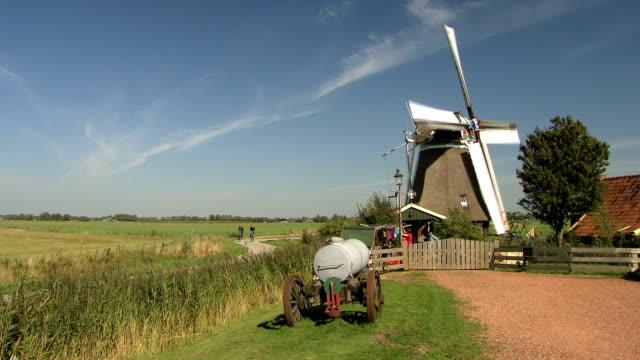 Dutch windmill in meadow, the Netherlands video