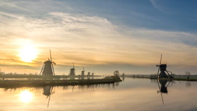 Dutch Windmill sunrise time lapse at Kinderdijk Village Netherlands, 4K timelapse Dutch Windmill sunrise time lapse at Kinderdijk Village Netherlands, 4K timelapse dutch architecture stock videos & royalty-free footage