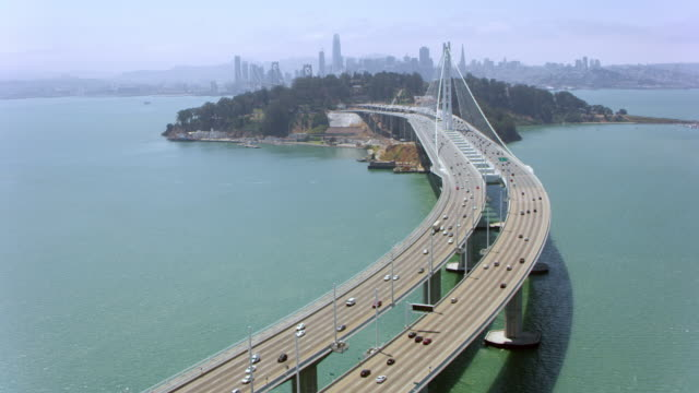 AERIAL Dwight D. Eisenhower highway and Yerba Buena Island between Oakland and San Francisco Aerial shot of the Dwight D. Eisenhower highway across Yerba Buena Island in Oakland California. Shot in the USA. oakland stock videos & royalty-free footage