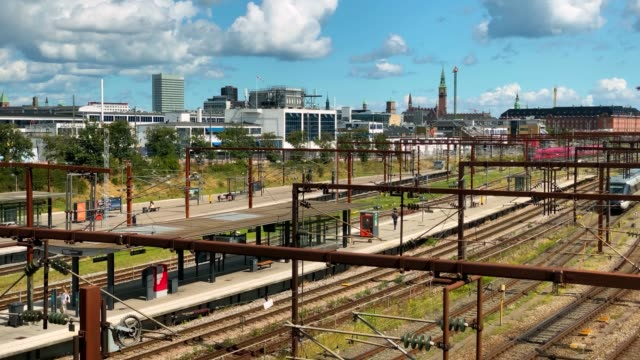Dybbolsbro train station, with trains and people. Time lapse video. Copenhagen.Copenhagen, Denmark. 2020, July.