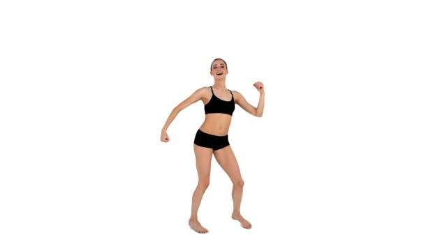 dynamiczne brunette w odzieży sportowej taniec - biustonosz sportowy filmów i materiałów b-roll