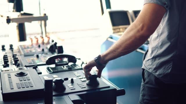 dynamic positioning officer operationg bridge ship equipment of vessel - leva video stock e b–roll