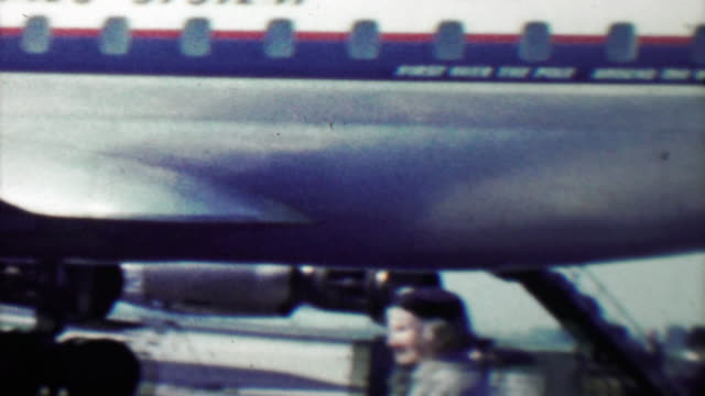 1961: Early 60's style woman deplaning Danish Airlines flight.