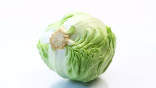 early green cabbage, whole swing on a white background video