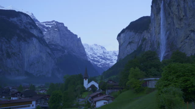 Early Morning at Lauterbrunnen Waterfall and Village in Switzerland in Spring Time