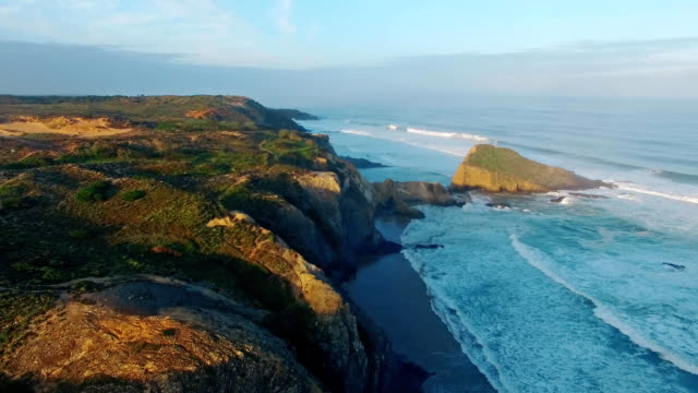 Early morning on the ocean cliffs Algarve Portugal aerial view video