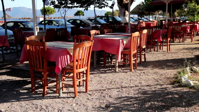 Early morning traditional colorful tavern restaurant by the beach video