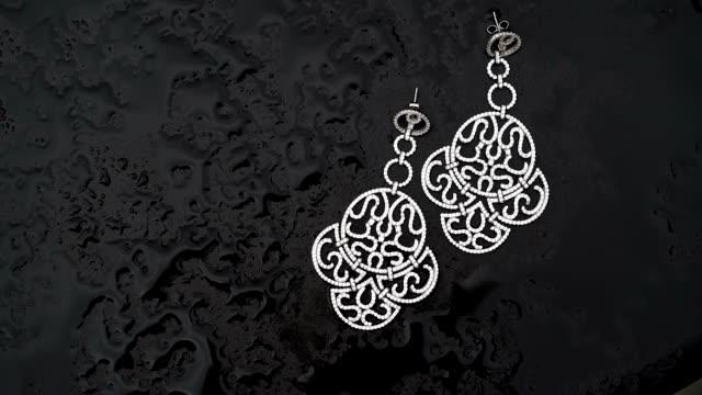 Earrings on wet table video