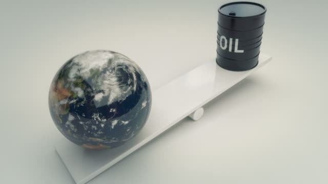 Earth and oil barrell on seesaw video