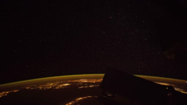 earth as seen through window of international space station iss - earth day stock videos and b-roll footage
