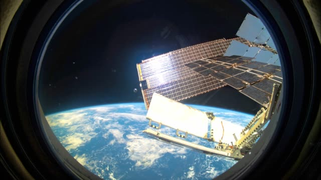 Earth as seen through window of International Space Station ISS video