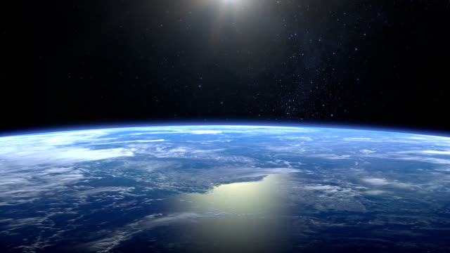 Earth from space. Flight over the Earth. 4K. Sunrise. The camera moves forward.