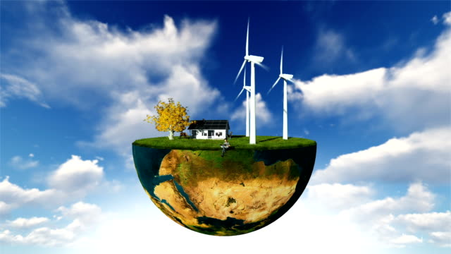 Earth globe holding wind turbines and happy family against blue sky video