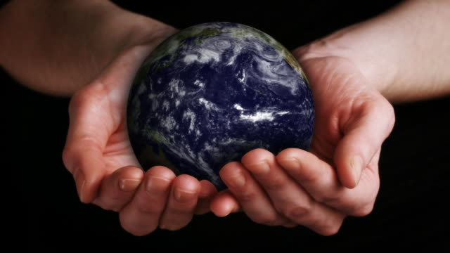 Earth in Hands (Loopable) HD video