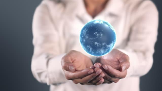 Earth in hands video