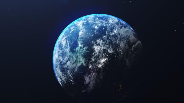 vidéos et rushes de la terre dans la vue de l'espace avec le lever du soleil brillant dans l'univers et le fond de galaxie. concept nature et environnement mondial. science et globe. ambiance de ciel fantastique. zoom arrière. séquences vidéo 4k - espace texte