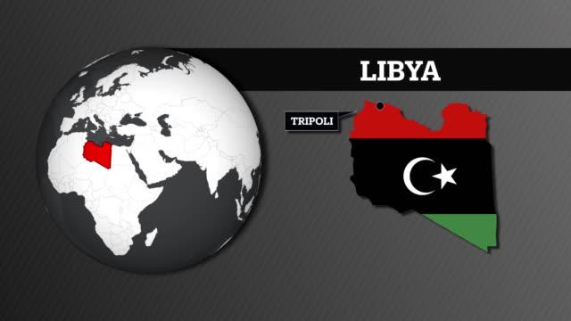 mappa della sfera terrestre e mappa del paese della libia con bandiera nazionale - libia video stock e b–roll