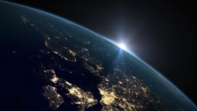 Earth Sunrise over the UK and Northern Europe Sun rises over Earth to reveal the UK and Northern Europe. Rendered in 4K. uk map stock videos & royalty-free footage