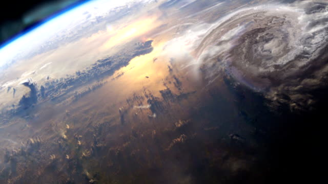 Earth surface seen from space. Northern lights and hurricane. NASA Public Domain Imagery