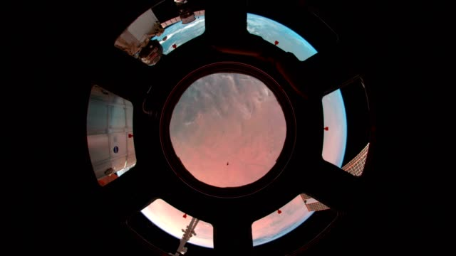 Earth through the porthole of the ISS. Elements of this video furnished by NASA video