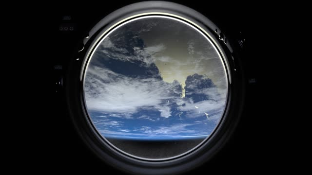 earth through the porthole window of spaceship. international space station is orbiting the earth. realistic atmosphere. 3d volumetric clouds. space. iss. the earth rotates backward. 4k. - nieważkość filmów i materiałów b-roll