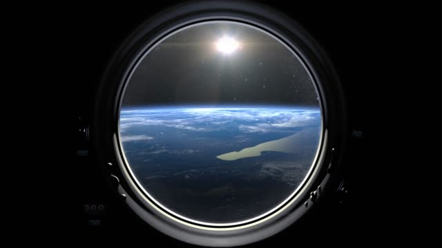 earth through the porthole window of spaceship. the sun in the window. international space station is orbiting the earth. movement to the right. realistic atmosphere. iss. 4k. - earth day stock videos & royalty-free footage
