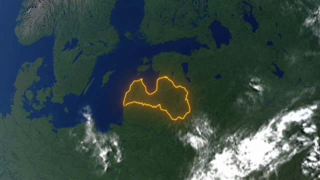 earth with borders of latvia - латвия стоковые видео и кадры b-roll