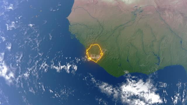 earth with borders of sierra leone - sierra leone video stock e b–roll