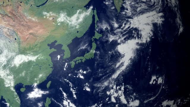 земля масштабирования по центру японии (с альфа-матовый - линия экватора стоковые видео и кадры b-roll