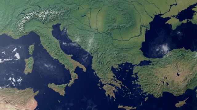 earth  zoom centered on northern italy (with alpha matte) - ekvatorn latitud bildbanksvideor och videomaterial från bakom kulisserna