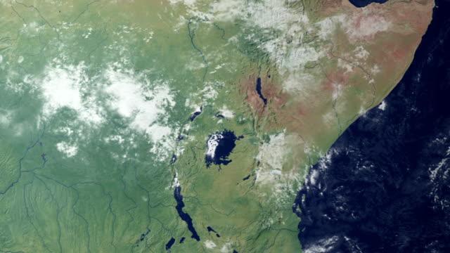 earth zooming in on… kenia (with alpha matte) - ekvatorn latitud bildbanksvideor och videomaterial från bakom kulisserna