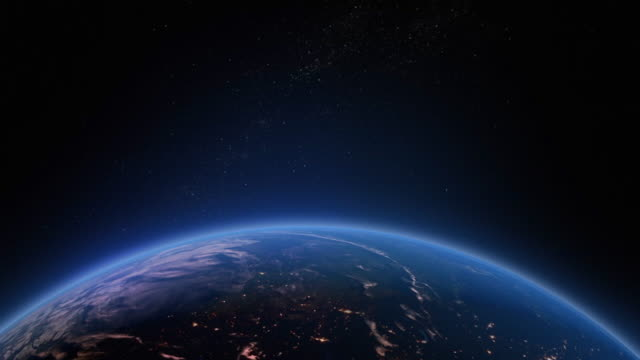 Earths atmosphere as viewed from space with the suns light starting to rise as the earth rotates Earths atmosphere as viewed from space with the suns light starting to rise as the earth rotates. stratosphere stock videos & royalty-free footage